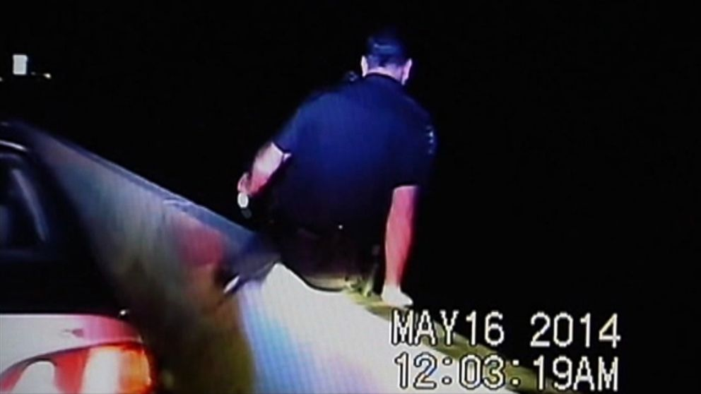 The officer was hospitalized after he leaped from an overpass to avoid a suspected drunk driver.