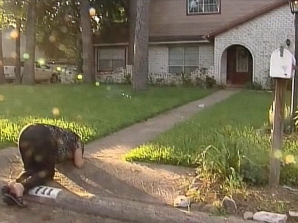 PHOTO: A woman pays her respects in front of the Stay familys Spring, Texas home where the fatal shooting took place Wednesday night