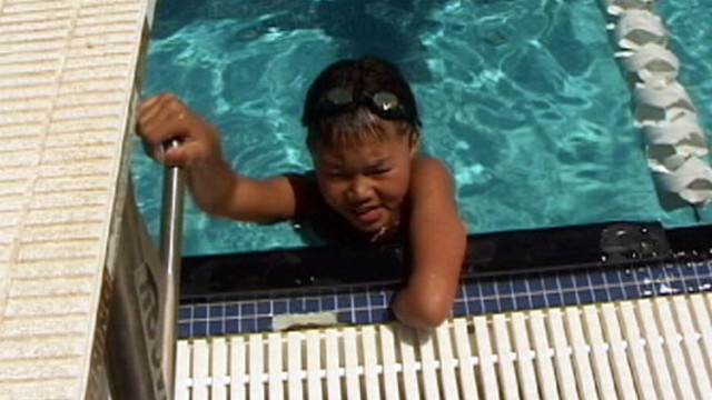 VIDEO: One-armed swimmer Ben Ramirez, 10, has won gold and bronze medals for his team.