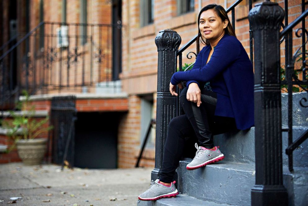 PHOTO: Sherile Pahagas, 33, now lives in Queens with her 2-year-old son and continues to earn a living as a domestic worker.