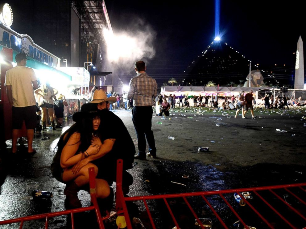 PHOTO: People take cover at the Route 91 Harvest country music festival after gun fire was heard, Oct. 1, 2017 in Las Vegas, Nevada.