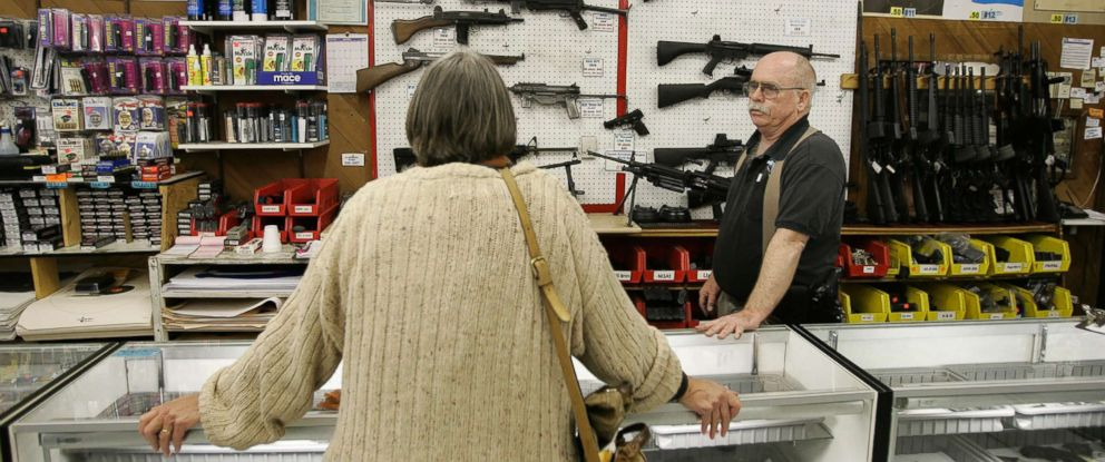 PHOTO: Janet Goff, a visitor from Cardiff, Calif., looks over a selection of machine guns inside The Gun Store in Las Vegas, March 29, 2006.