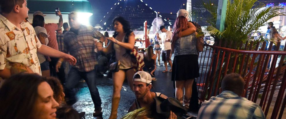 PHOTO: People run for cover at the Route 91 Harvest country music festival after gun fire was heard, Oct. 1, 2017 in Las Vegas.