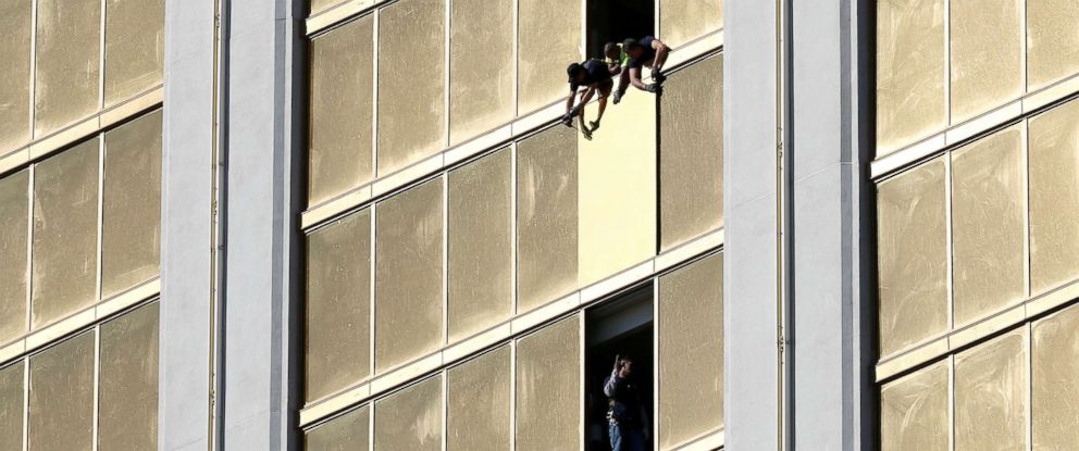 PHOTO: Workers board up a broken window at the Mandalay Bay hotel, where shooter Stephen Paddock conducted his mass shooting along the Las Vegas Strip, in Las Vegas, Nevada, Oct. 6, 2017.