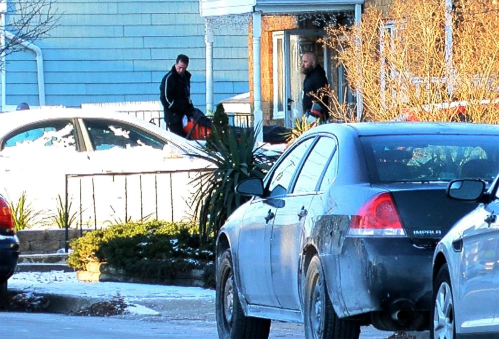 PHOTO: Investigators remove a body from the home in Long Branch, NJ, January 1, 2018, where a 16-year-old boy shot and killed 3 family members and a friend on New Years Eve.