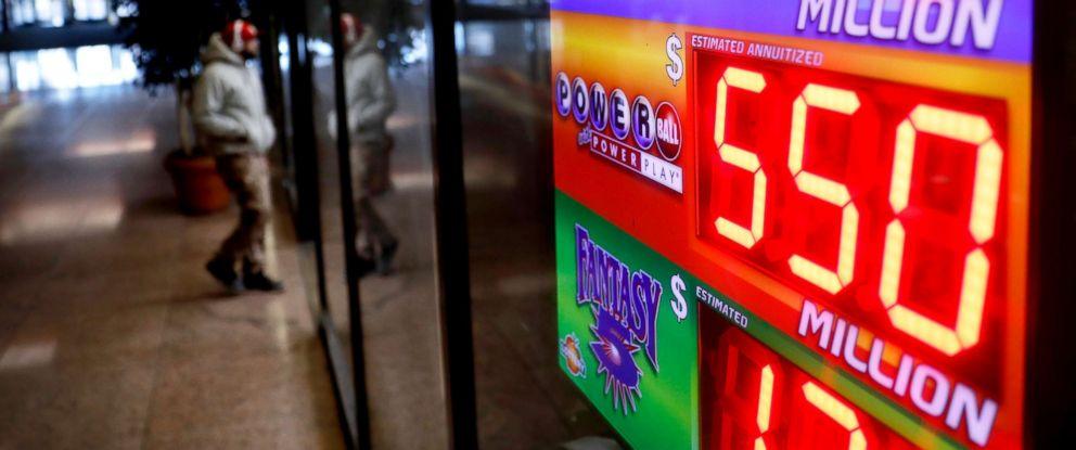 PHOTO: A sign advertises Powerball and Mega Millions lottery jackpots at a store in Atlanta, Georgia, Jan. 4, 2018.