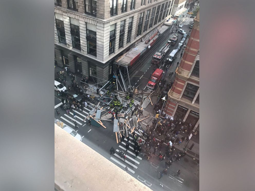 'PHOTO: Courtney Davis tweeted this image of huge scaffolding that fell below her apartment on Prince and Broadway in the Soho neighborhood, Nov. 19, 2017 in New York.' from the web at 'http://a.abcnews.com/images/US/lower-manhattan-scaffolding-collapse-5-ht-jt-171119_v4x3_4x3_992.jpg'