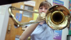 PHOTO: Sarah McKinney, a 5th grade student at Carleton School in Penns Grove, plays the trombone with the use of prosthetics.