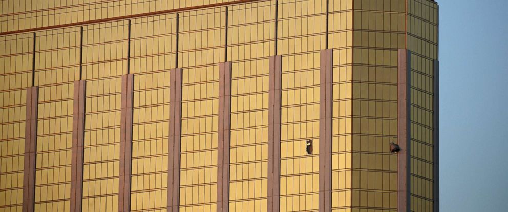 PHOTO: Drapes billow out of broken windows at the Mandalay Bay resort and casino, Oct. 2, 2017, on the Las Vegas Strip following a deadly shooting at a music festival in Las Vegas.