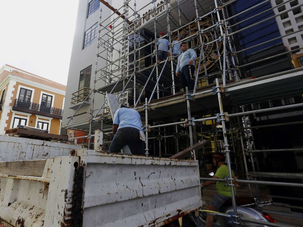 PHOTO: Workers dismantle a scaffold, in San Juan, Puerto Rico, as the city prepares for the arrival of hurricane Maria which is approaching both the Virgin Islands and Puerto Rico with winds of 160 miles per hour, storm surges and torrential rains.