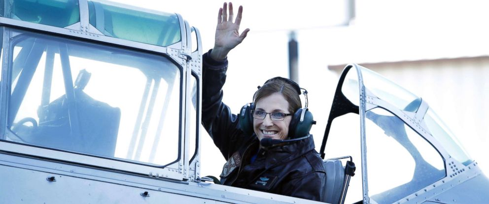 PHOTO: Rep. Martha McSally waves from a T-6 World War II airplane as she leaves for Phoenix, Jan. 12, 2018, in Tucson, Ariz.