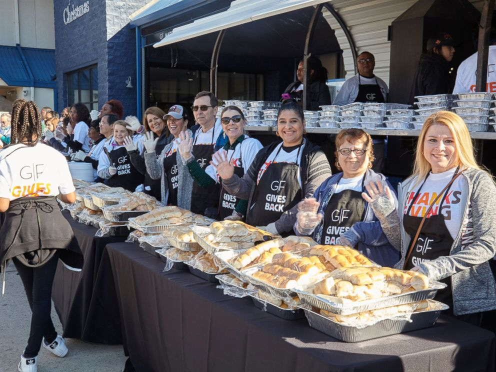 PHOTO: Volunteers prepare to serve food at the Thanksgiving dinner hosted by Gallery Furniture owner Jim McIngvale in Houston.