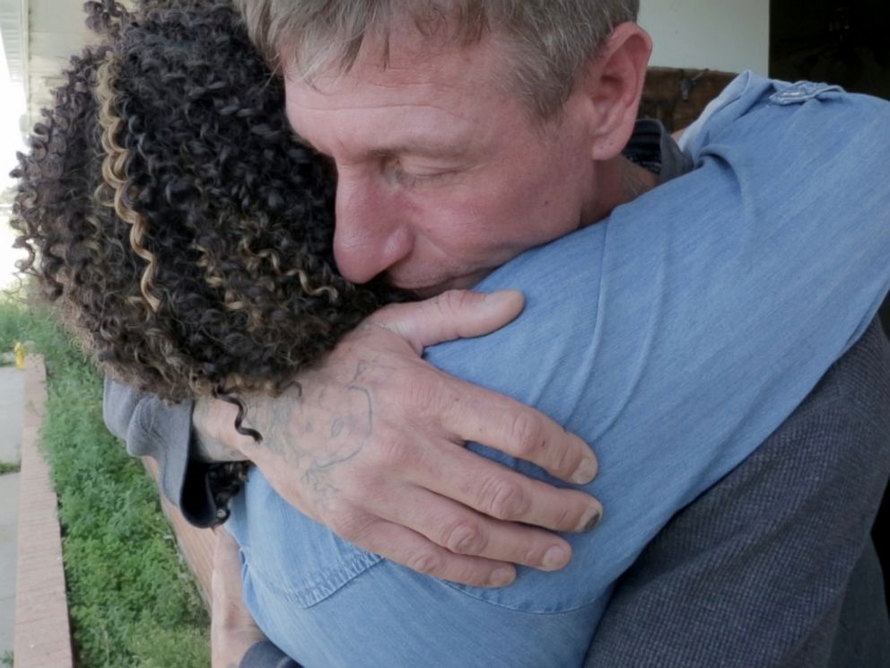 PHOTO: Former skinhead Michael Kent gives his former parole officer Tiffany Whittier a hug after she surprises him at his home.