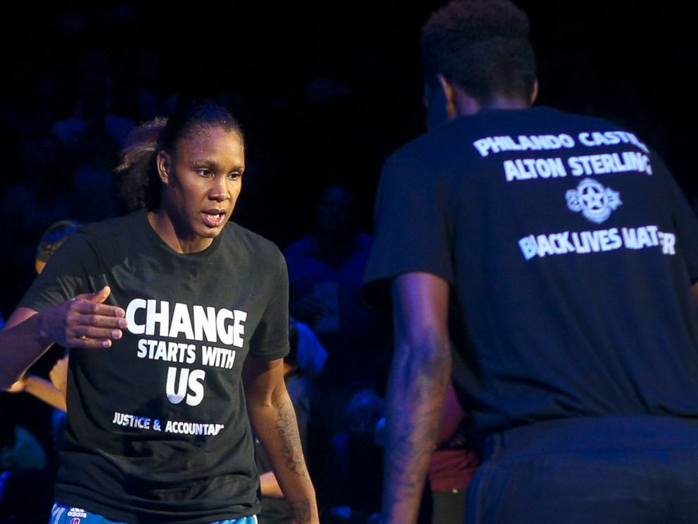 PHOTO: Minnesota Lynx forward Rebekkah Brunson (32) is greeted by Minnesota Lynx forward Natasha Howard (3) while starting lineups are announced at the Target Center, July 9, 2016.