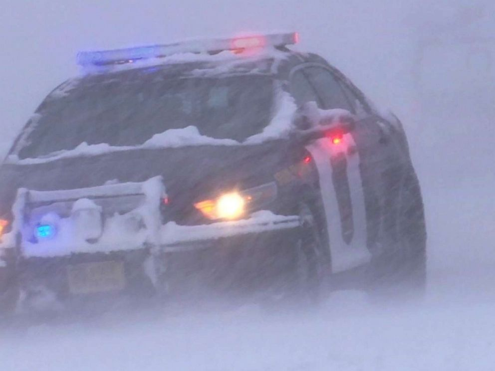 PHOTO: Police cruiser patrols through early winter weather that authorities confirms played a role to two fatal driver-related deaths, 25 injuries and over 161 spinouts.