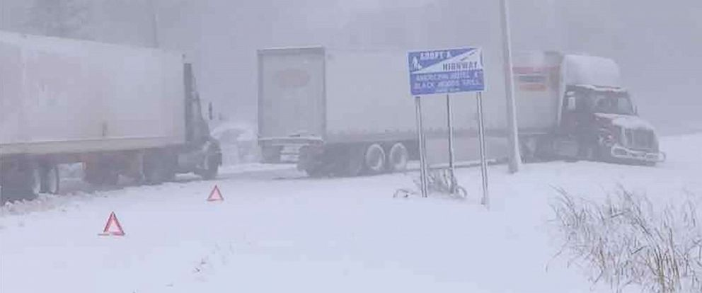 PHOTO: Big rig trucks crawl along Minnesota highways after blizzard conditions brought several inches of snow in October and led to two drivers losing their life.