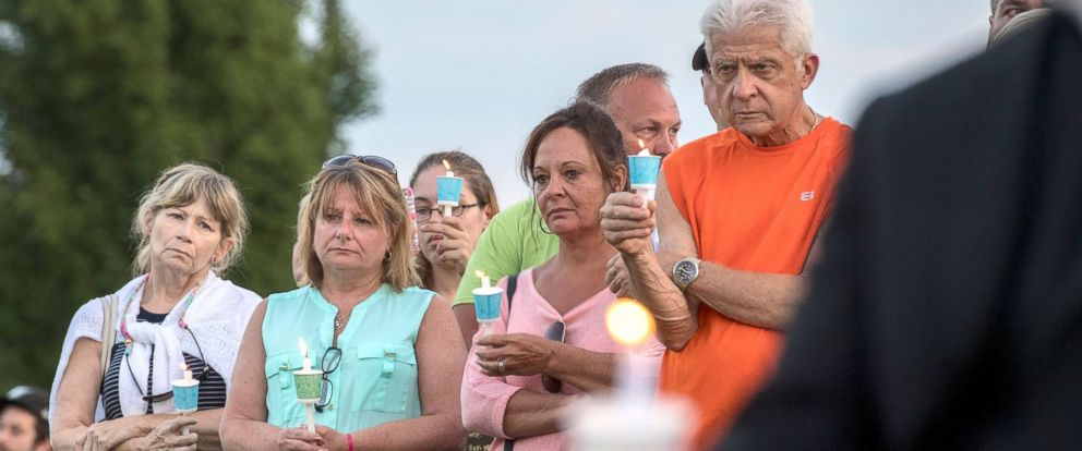 PHOTO: People hold candles during a prayer and candlelight vigil for four missing men who were killed and whose remains buried on a farm at the Garden of Reflection in Lower Makefield, Pa., July 16, 2017.