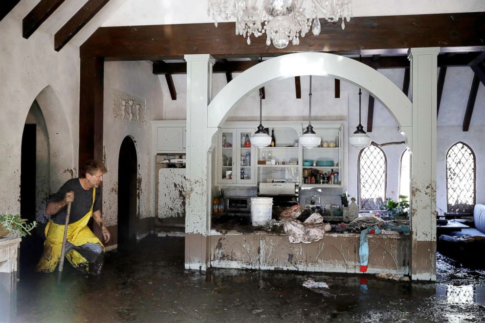 PHOTO: Bill Asher walks through mud in his home damaged by storms in Montecito, Calif., Thursday, Jan. 11, 2018.