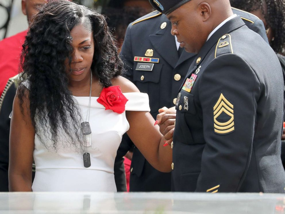 PHOTO: Myeshia Johnson, the wife of Army Sgt. La David Johnson at his casket after the burial at Hollywood Memorial Gardens, Oct. 21, 2017.