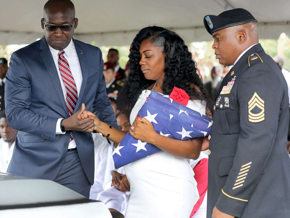 PHOTO: Myeshia Johnson, the wife of Army Sgt. La David Johnson, looks down at his casket after the burial at Hollywood Memorial Gardens, Oct. 21, 2017, in Ft. Lauderdale, Fla.