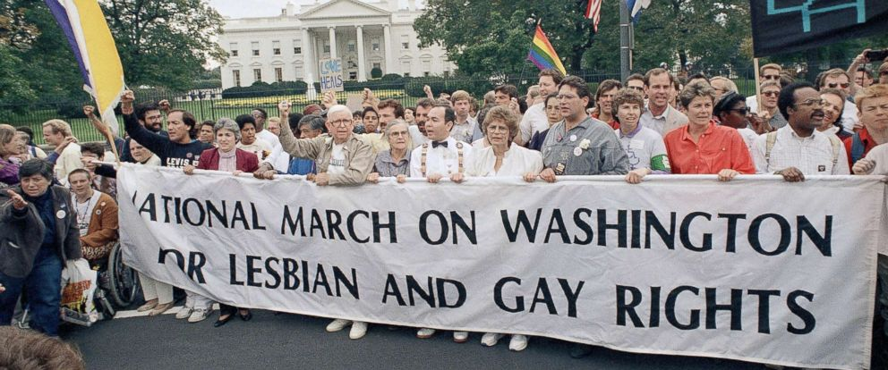 PHOTO: Participants of the National March on Washington for Lesbian and Gay Rights carry a banner as they parade in front of the White House, Oct. 11, 1987, Washington.