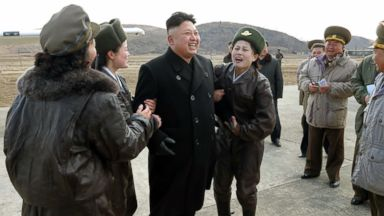 PHOTO: This undated picture released by North Koreas official news agency KCNA on March 7, 2014 shows Kim Jong-Un with female pilots as he inspects the Korean Peoples Army Air and Anti-Air Force Unit 2620 at an undisclosed location in North Korea.