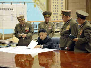 NKorea Vows to Restart Nuclear Facilities