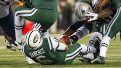 PHOTO: Mark Sanchez fumbles the ball in this Nov. 22, 2012 file photo taken during the NFL Thanksgiving Day game between the New England Patriots and the New York Jets at MetLife Stadium in East Rutherford, New Jersey.