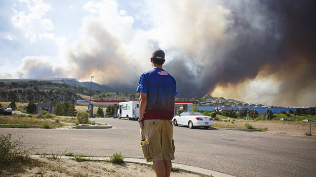 PHOTO: Man watches wildfire from Colorado Springs