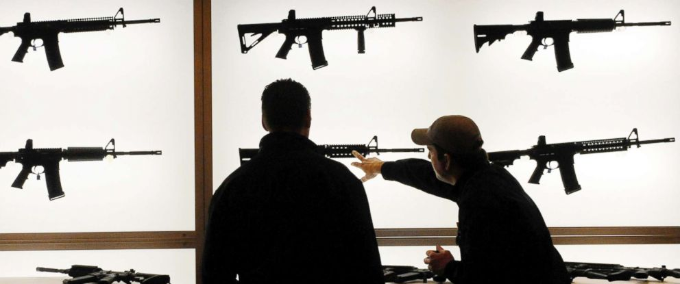 PHOTO: Gun dealers look over the Daniel Defense rifle display at The Shooting, Hunting and Outdoors Trade Show, Jan. 21, 2010.