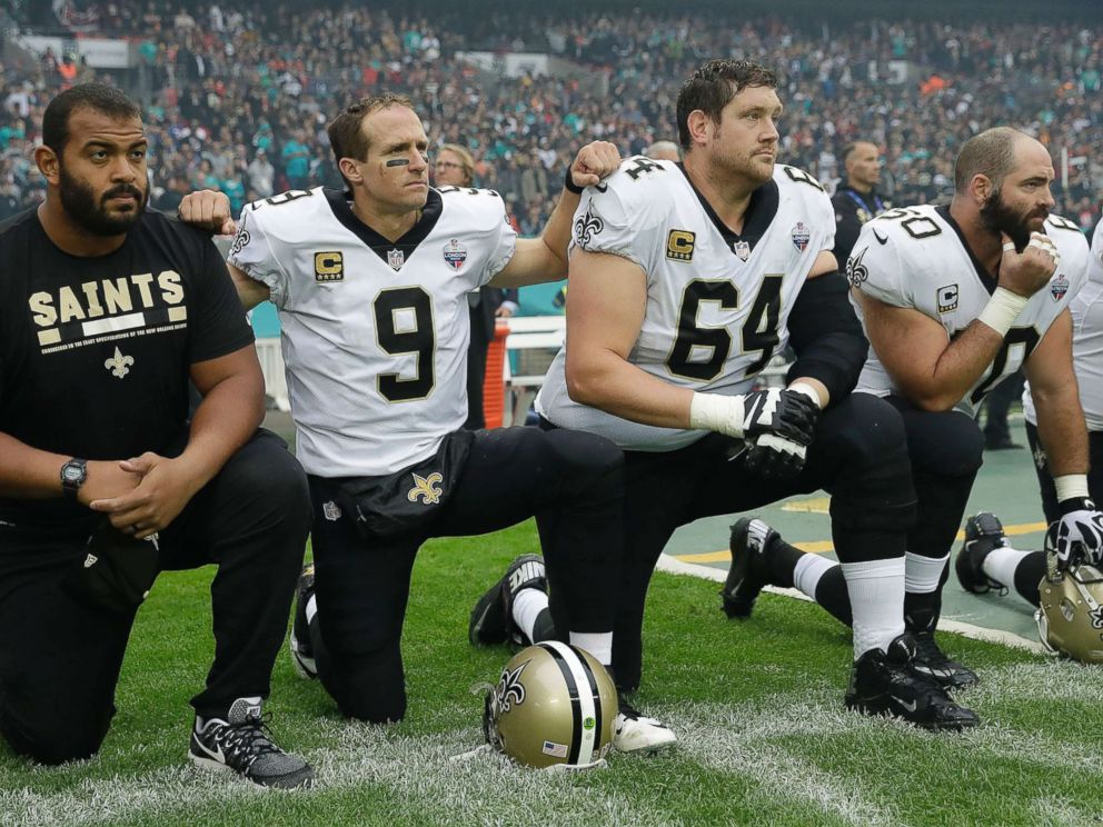 PHOTO: New Orleans Saints quarterback Drew Brees (9) kneels down with teammates before the U.S. national anthem was played ahead of an NFL football game against Miami Dolphins at Wembley Stadium in London, Oct. 1, 2017.