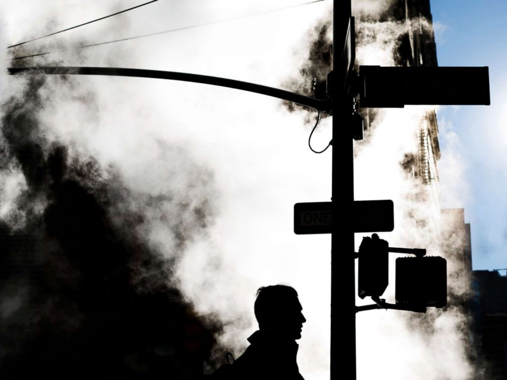PHOTO: A pedestrian walks past a cloud of steam coming from a manhole on a brisk morning in New York City, Nov. 10, 2017.