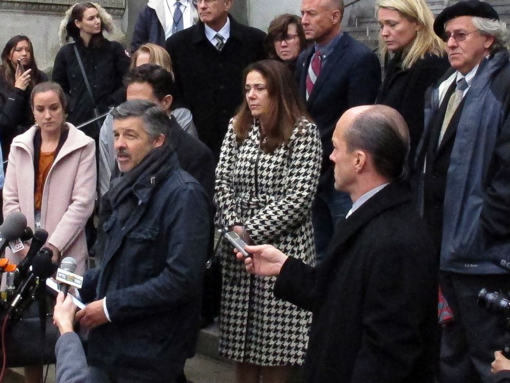 PHOTO: Ian Hockley, front left, father of Dylan Hockley, one of the children killed in the 2012 Sandy Hook Elementary School shooting, speaks outside the Connecticut Supreme Court, Nov. 14, 2017, in Hartford, Conn.