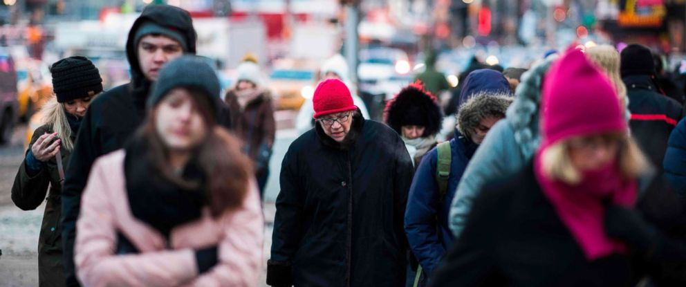 PHOTO: People brave the cold weather as they make their way through New York City, Jan. 5, 2018.