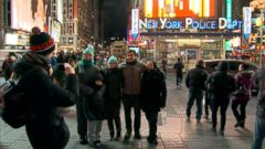 'PHOTO: Visitors take a picture in front of the New York Police Department station in Times Square, New York.' from the web at 'http://a.abcnews.com/images/US/nyc-security-dept-abc-ps-171228_16x9_240.jpg'