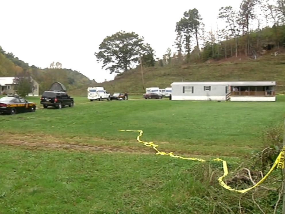 PHOTO: Crime scene tape and police vehicles at the scene of a quadruple killing in Lawrence County, Ohio.