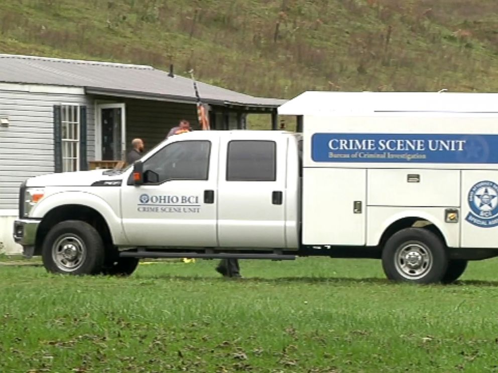 PHOTO: A truck investigating the crime scene is parked in front of the home in Lawrence County, Ohio.