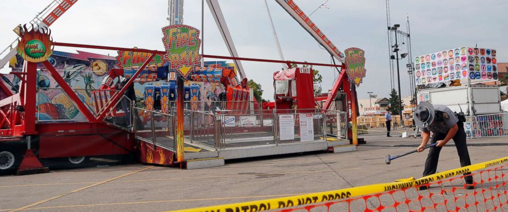 PHOTO: An Ohio State Highway Patrol trooper removes a ground spike from in front of the fire ball ride at the Ohio State Fair Thursday, July 27, 2017, in Columbus, Ohio.