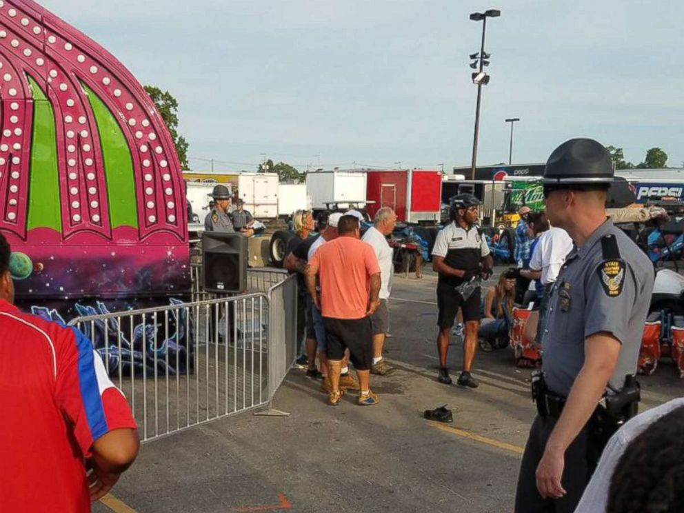 PHOTO: Authorities respond near the Fire Ball amusement ride after the ride malfunctioned injuring several at the Ohio State Fair, July 26, 2017, in Columbus, Ohio.