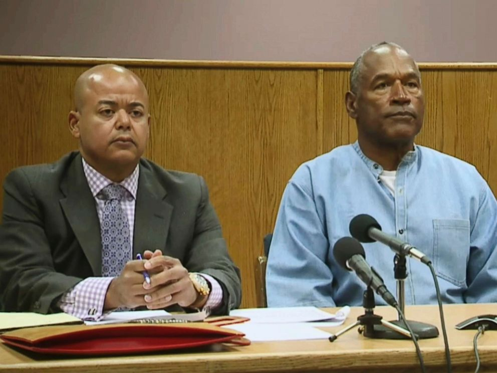 PHOTO: Former NFL football star O.J. Simpson appears with his attorney, Malcolm LaVergne, left, via video for his parole hearing at the Lovelock Correctional Center in Lovelock, Nev., on July 20, 2017.
