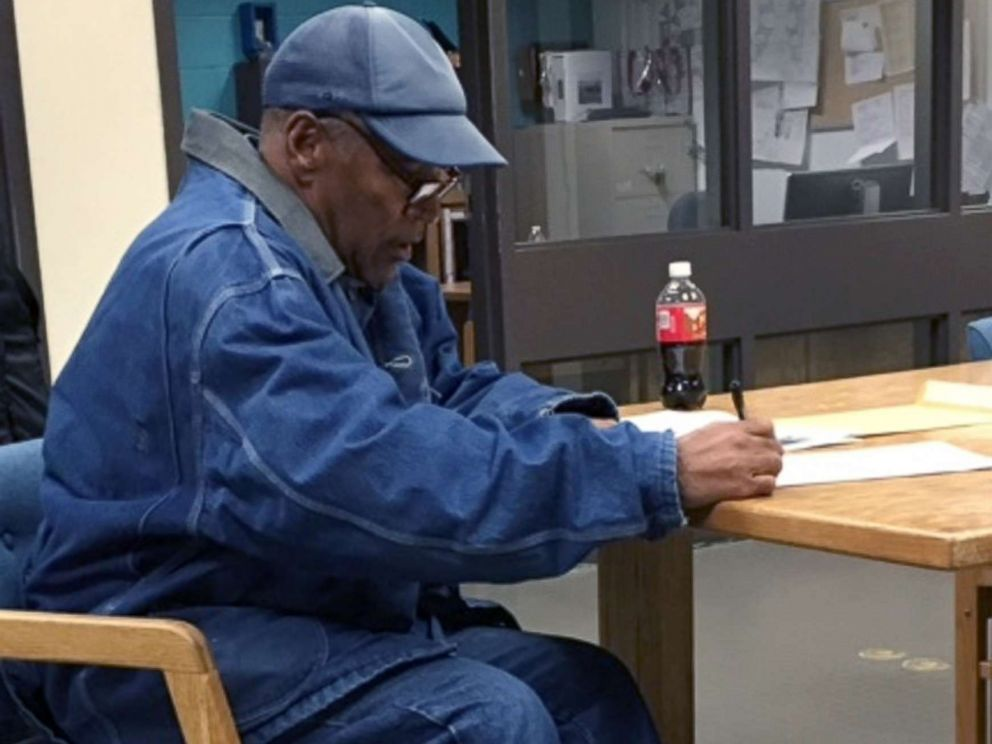 PHOTO: O.J. Simpson signs paperwork before his release from Lovelock Correctional Center Sept. 30, 2017 in Lovelock, Nev.