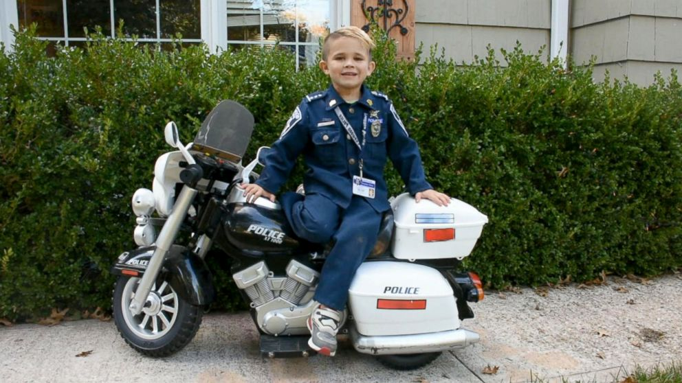 'They're my superheroes': Boy, 6, serves lemonade and doughnuts to police