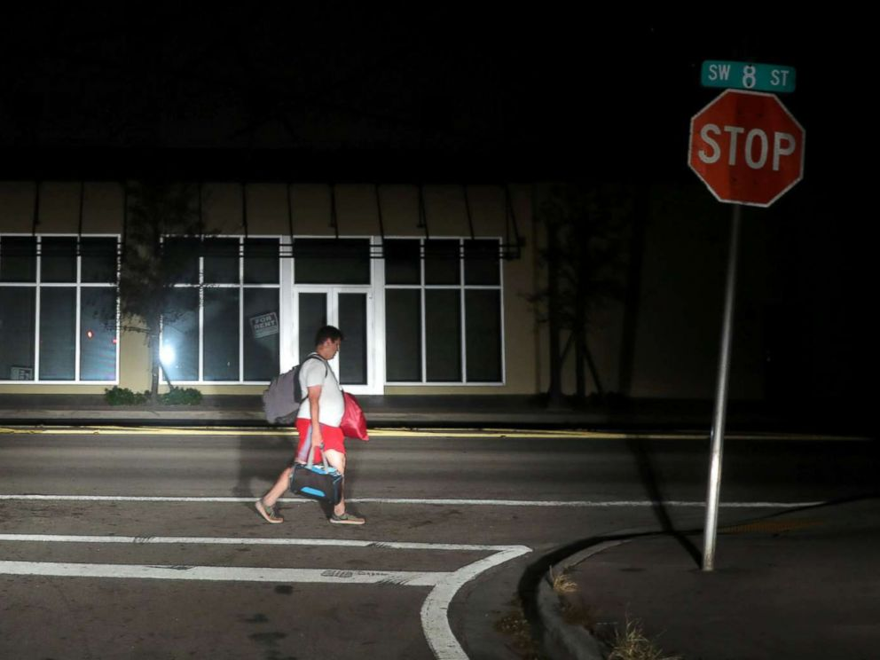 PHOTO: A man walks back home in the darkness as many areas of Miami still without electricity after Hurricane Irma strikes Florida, in Little Havana, Miami, Fla., Sept. 11, 2017.