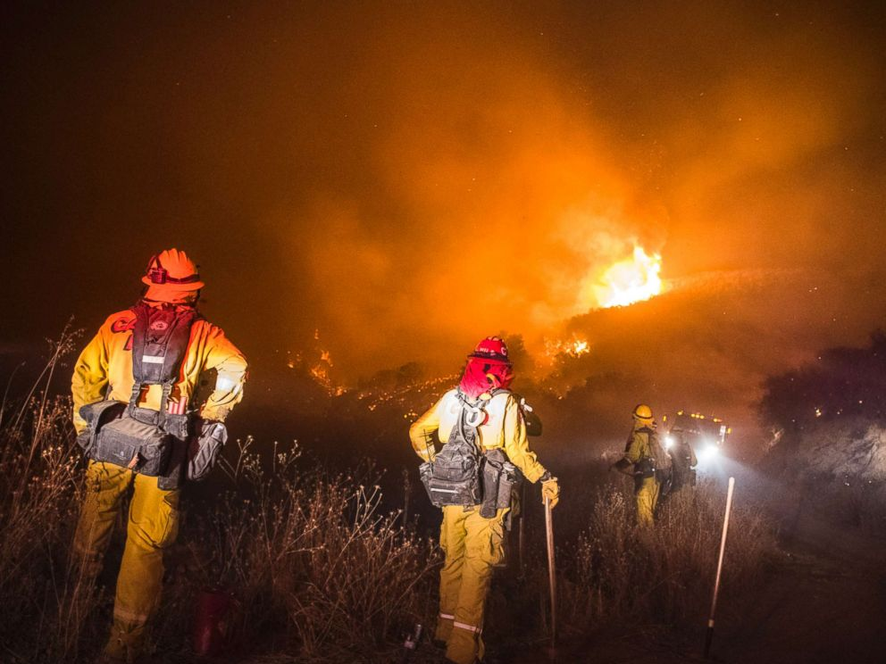 PHOTO: Firefighters watch for embers crossing over the road early Thursday morning, Dec. 14, 2017 at the Thomas Fire during a firing operation in the hills above Los Padres National Forest, Calif. <p itemprop=