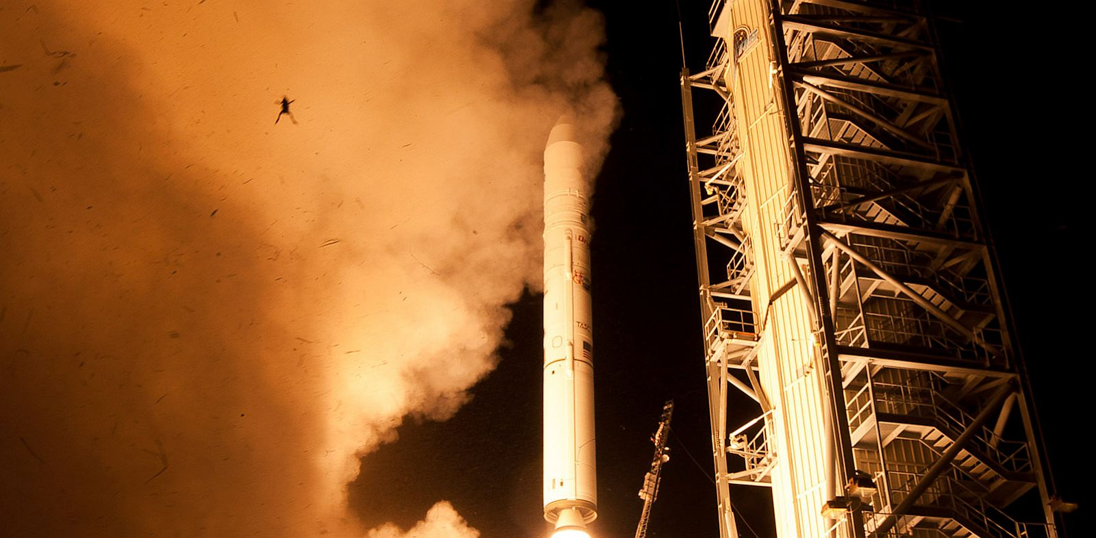 PHOTO: A still camera on a sound trigger captured this photo of an airborne frog as NASAs LADEE spacecraft lifted off from Pad 0B at Wallops Flight Facility in Virginia.