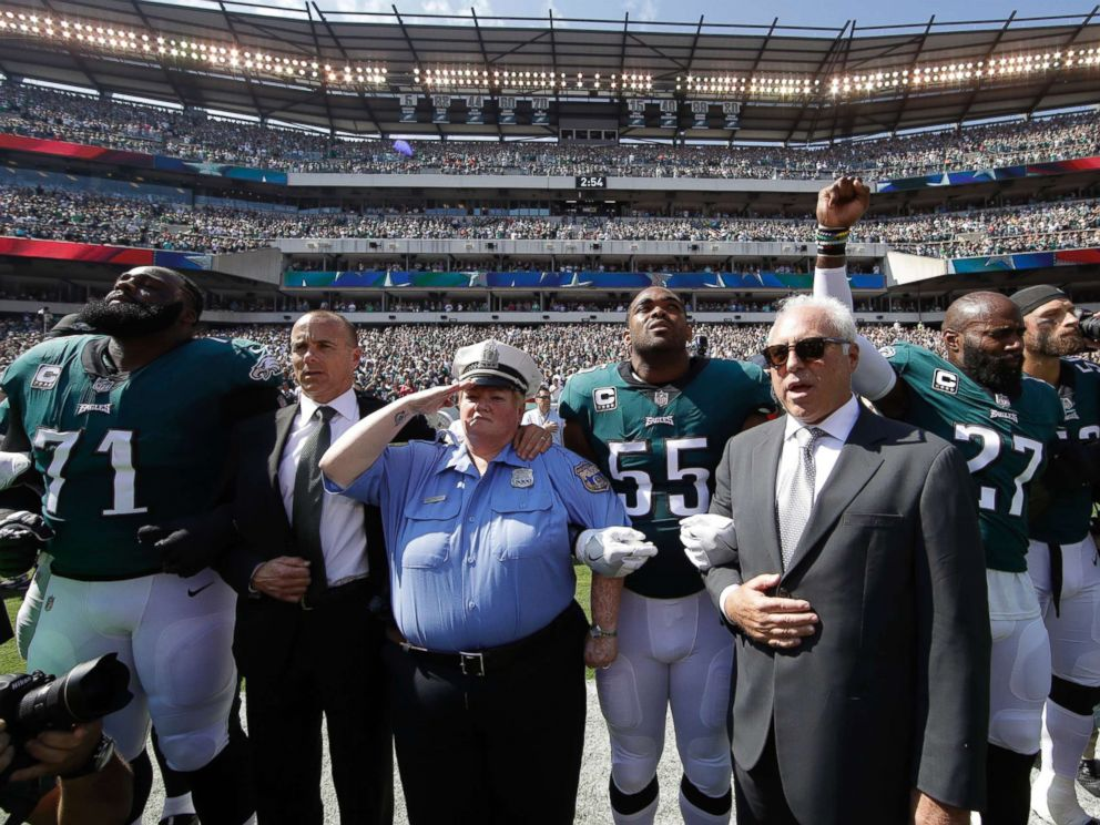 PHOTO: Philadelphia Eagles players and owners Jeffrey Lurie stand for the national anthem before an NFL football game against the New York Giants, Sept. 24, 2017, in Philadelphia.