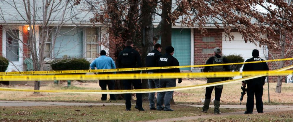 PHOTO: Police officers work the scene where two St. Louis County officers were shot and a man barricaded himself inside a home on Thursday, Dec. 14, 2017, in the St. Louis County town of Bellefontaine Neighbors.