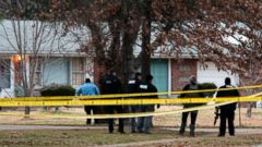 'PHOTO: Police officers work the scene where two St. Louis County officers were shot and a man barricaded himself inside a home on Thursday, Dec. 14, 2017, in the St. Louis County town of Bellefontaine Neighbors.' from the web at 'http://a.abcnews.com/images/US/police-missouri-2-ap-er-171214_16x9t_240.jpg'