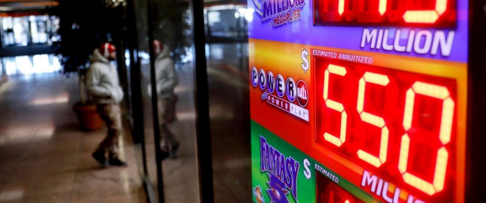 PHOTO: A sign advertises Powerball and Mega Millions lottery jackpots at a store in Atlanta, Jan. 4, 2018.