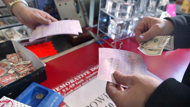 PHOTO: A lottery player buys a Powerball ticket in this file photo from December 30, 2003.
